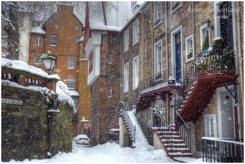 Ramsay Garden with snow falling