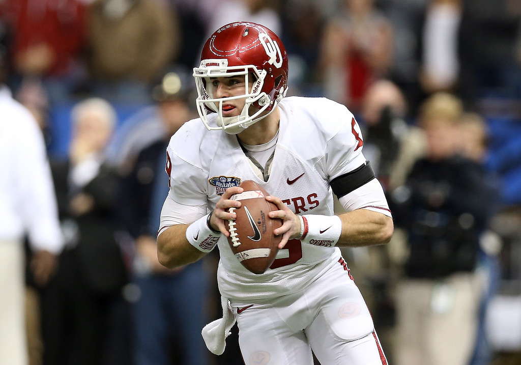 . NEW ORLEANS, LA - JANUARY 02:  Trevor Knight #9 of the Oklahoma Sooners look to pass against the Alabama Crimson Tide during the Allstate Sugar Bowl at the Mercedes-Benz Superdome on January 2, 2014 in New Orleans, Louisiana.  (Photo by Sean Gardner/Getty Images)