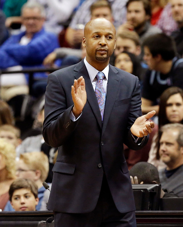 . Denver Nuggets head coach Brian Shaw applauds his players in the second half of an NBA basketball game against the Minnesota Timberwolves, Wednesday, Nov. 27, 2013, in Minneapolis. The Nuggets won 117-110. (AP Photo/Jim Mone)