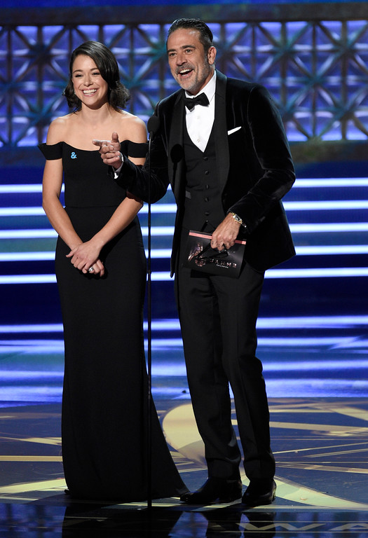 . Tatiana Maslany , left, and Jeffrey Dean Morgan present the award for outstanding lead actress in a drama series at the 69th Primetime Emmy Awards on Sunday, Sept. 17, 2017, at the Microsoft Theater in Los Angeles. (Photo by Chris Pizzello/Invision/AP)