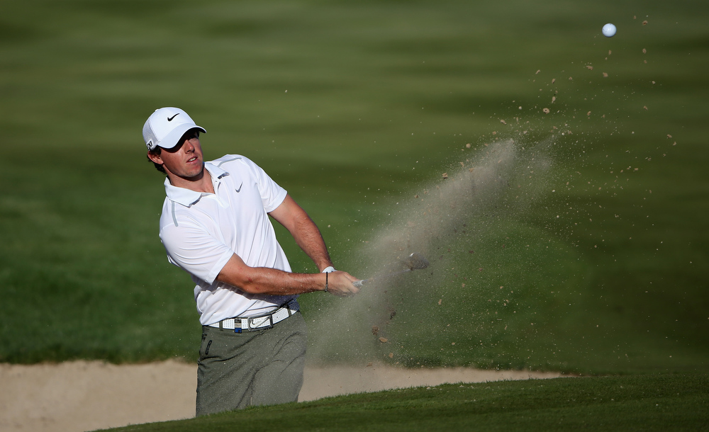 . Rory McIlroy of Northern Ireland plays his third shot par four 16th hole during the second round of the Abu Dhabi HSBC Golf Championship at the Abu Dhabi Golf Club on January 18, 2013 in Abu Dhabi, United Arab Emirates.  (Photo by Ross Kinnaird/Getty Images)