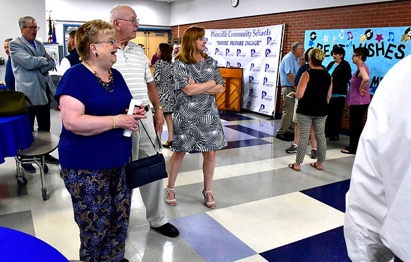 6/11/2019 Mike Orazzi | Staff Maureen Brummett and her parents Beverly and Tim Luddy during her farewell reception at Plainville High School on Tuesday.