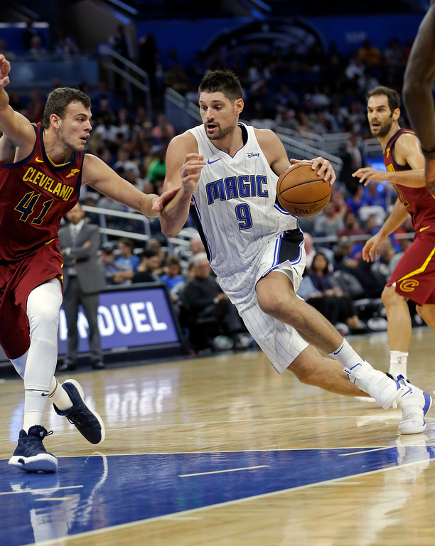 . Orlando Magic\'s Nikola Vucevic (9) makes a move to get past Cleveland Cavaliers\' Ante Zizic (41) during the second half of an NBA preseason basketball game, Friday, Oct. 13, 2017, in Orlando, Fla. Cleveland won 113-106. (AP Photo/John Raoux)