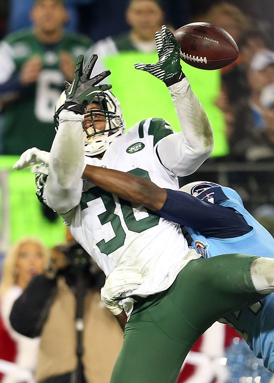 . NASHVILLE, TN - DECEMBER 17:  Free safety LaRon Landry #30 of the New York Jets attempts to intercept the ball against the Tennessee Titans at LP Field on December 17, 2012 in Nashville, Tennessee.  (Photo by Andy Lyons/Getty Images)