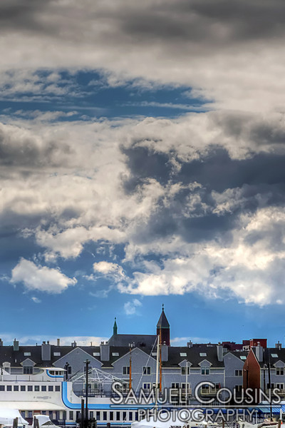Clouds over Dimillo's and Chandler's wharf. That's St Louis Roman Catholic Church in the back.