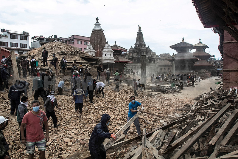 Rescuers dig through the rubble at Patan Durbar Square