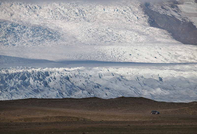 En route to Jukuslarlon the mighty Vatnajokull glacier spills out at many locations. Frozen ice meets land. Truly amazing to see and one can't help wondering why it just doesn't all melt! Really difficult to get a sense of scale too, until something like a car come along :-)