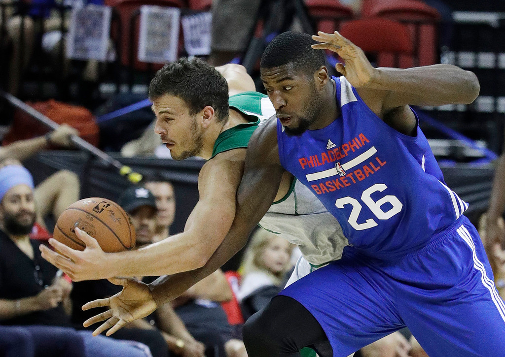 . Philadelphia 76ers\' Mathias Lessort, right, of France, battles for the ball with Boston Celtics\' Ante Zizic, of Croatia, during the first half of an NBA summer league basketball game, Tuesday, July 11, 2017, in Las Vegas. (AP Photo/John Locher)