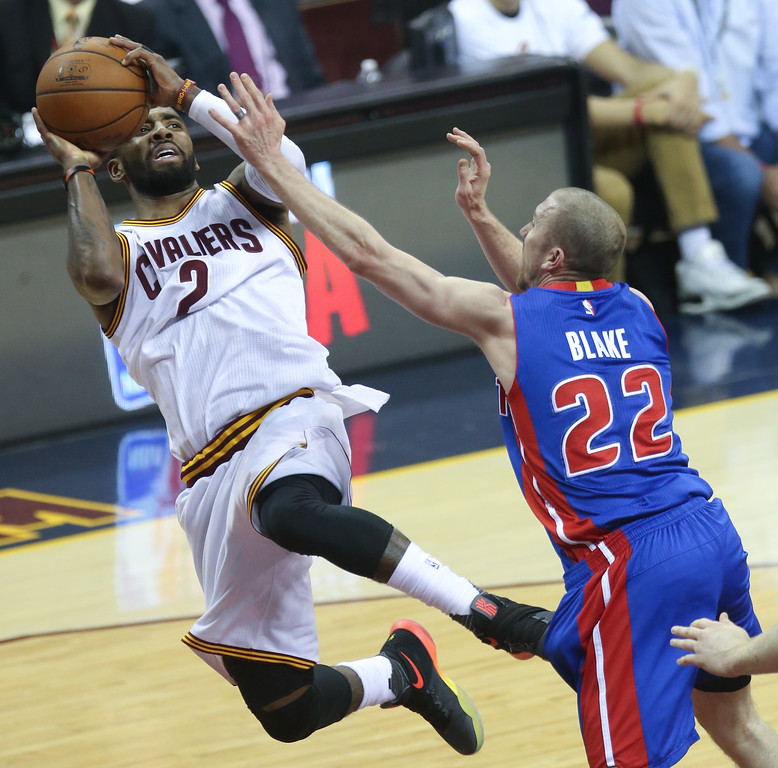 . Detroit Pistons\' Steve Blake (22) defends against the Cleveland Cavaliers Kyrie Irving during the first half of Game 1 of a first-round NBA basketball playoff series, Sunday, April 17, 2016, in Cleveland. (Kirthmon F. Dozier/Detroit Free Press via AP)