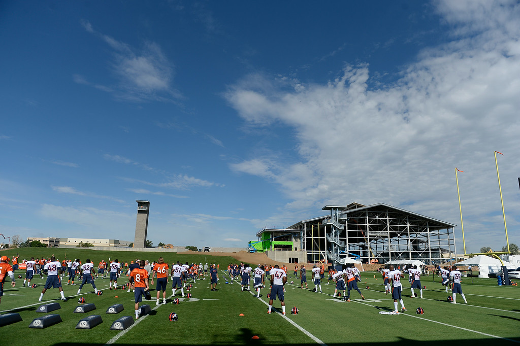 . The Denver Broncos stretch on the first day of the 2014 training camp July 24, 2014 at Dove Valley. (Photo by John Leyba/The Denver Post)
