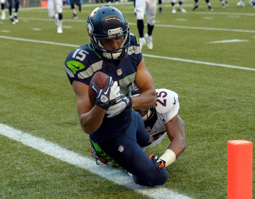 . SEATTLE, WA. - AUGUST 17: Seattle Seahawks wide receiver Jermaine Kearse (15) lunges over the goal line for a touchdown on Denver Broncos cornerback Chris Harris (25) in the first quarter August 17, 2013 at Century Link Field. (Photo By John Leyba/The Denver Post)