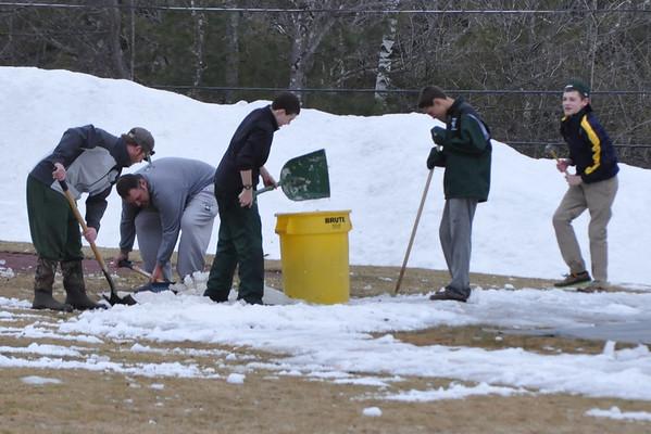 Shoveling the Baseball Field!