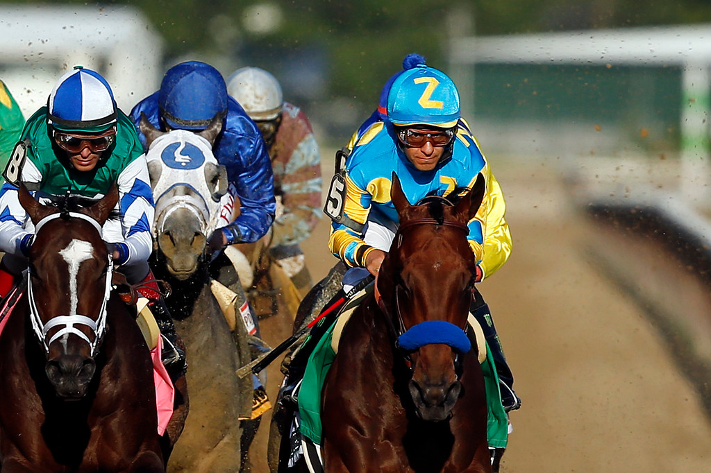 . American Pharoah (5), far right, leads Materiality (8) and the rest of the field down the back stretch on the way to a Triple Crown victory during the 147th running of the Belmont Stakes horse race at Belmont Park, Saturday, June 6, 2015, in Elmont, N.Y. (AP Photo/Jason DeCrow)