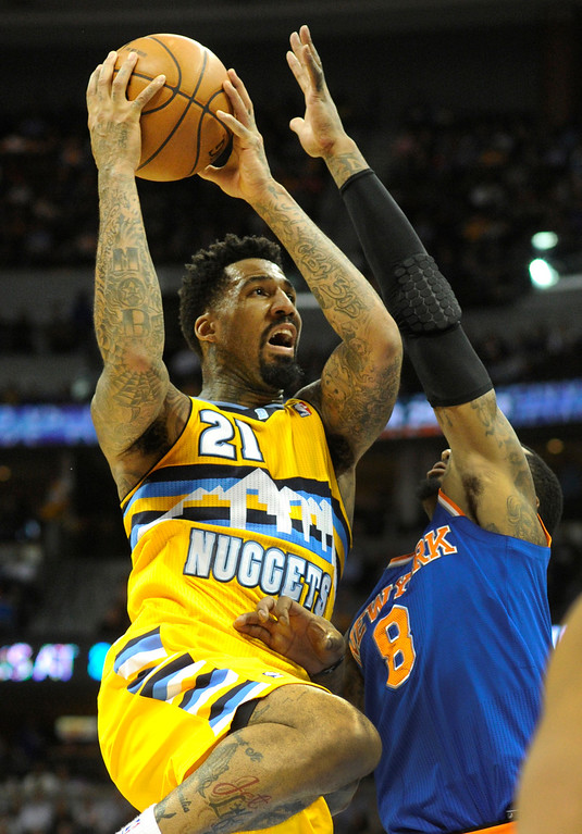 . DENVER, CO. - NOVEMBER 29: Denver forward Wilson Chandler (21) collided with J. R. Smith on the way to the basket in the second half. The Denver Nuggets defeated the New York Knicks 97-95 at the Pepsi Center Friday night, November 29, 2013. Photo By Karl Gehring/The Denver Post