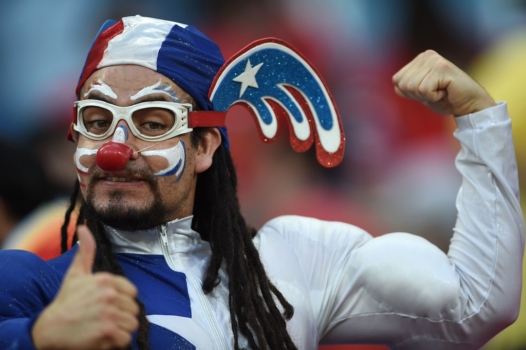. A Chilean football fan cheers for his team before the start of the Group B football match between Chile and Australia at the Pantanal Arena in Cuiaba during the 2014 FIFA World Cup on June 13, 2014. AFP PHOTO / MARTIN  BERNETTI/AFP/Getty Images