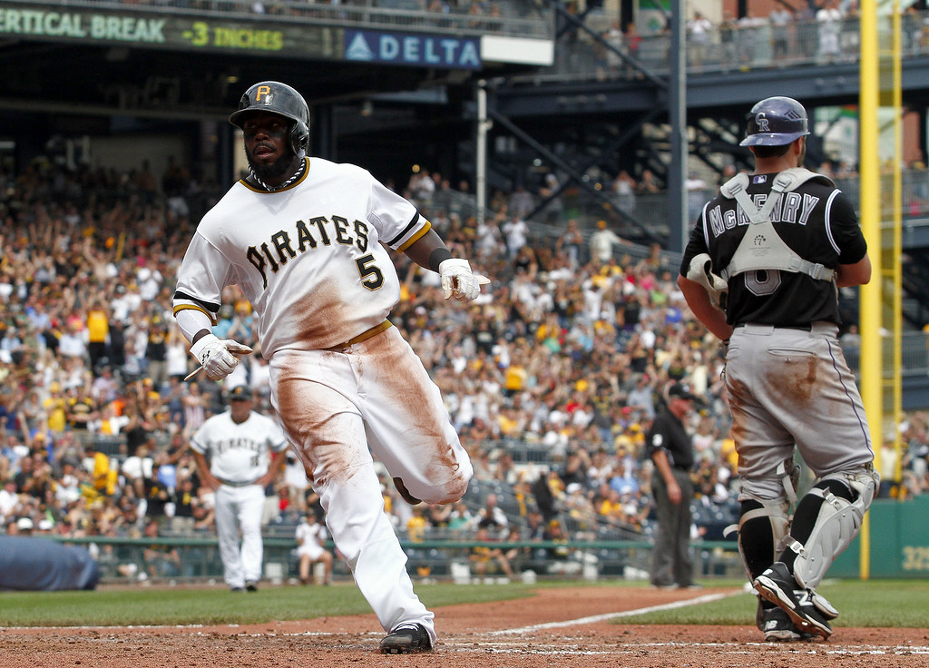 . Josh Harrison #5 of the Pittsburgh Pirates scores on an RBI single in the seventh inning against the Colorado Rockies during the game at PNC Park on July 20, 2014 in Pittsburgh, Pennsylvania.  (Photo by Justin K. Aller/Getty Images)