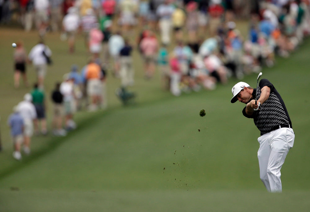 Description of . Nick Watney hits off the first fairway during the fourth round of the Masters golf tournament Sunday, April 14, 2013, in Augusta, Ga. (AP Photo/Charlie Riedel)