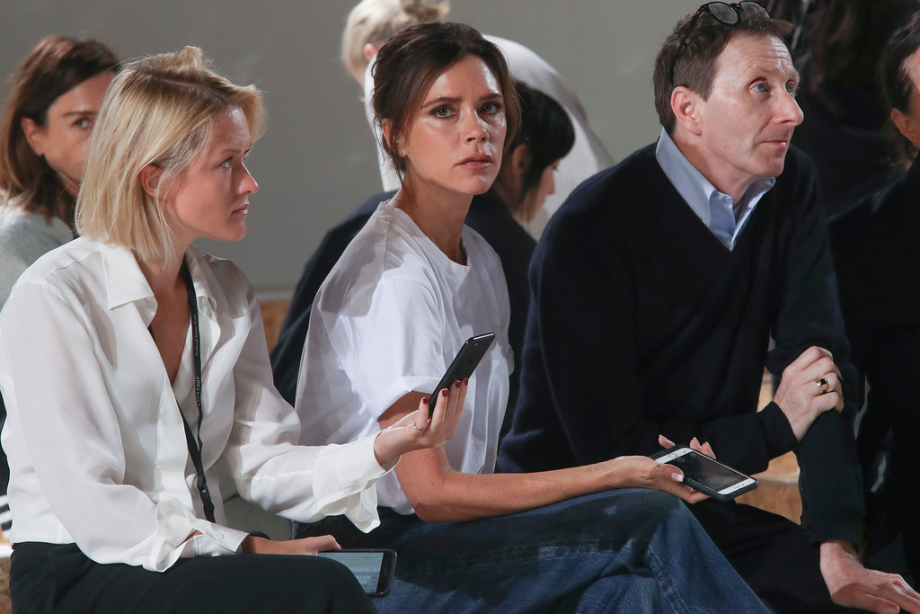 . Victoria Beckham, center, watches the rehearsal of her Spring/Summer 2018 fashion show during New York Fashion Week, Sunday, Sept. 10, 2017. (AP Photo/Mary Altaffer)