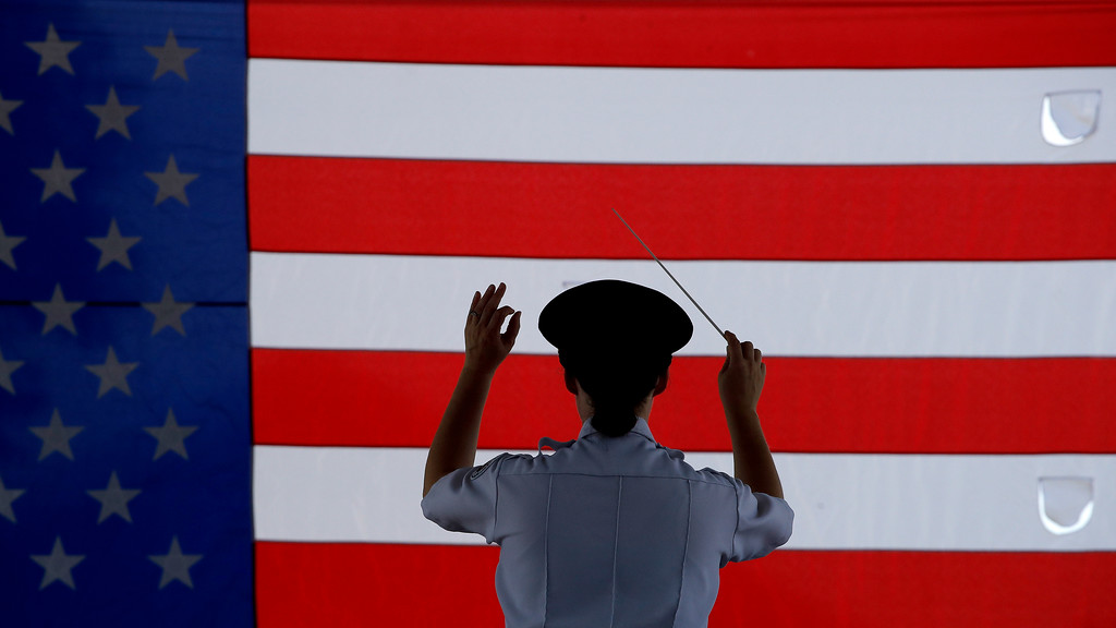 . Conductor Heather Pickett directs the band during an Independence Day concert by the American Legion Band of Greater Kansas City Wednesday, July 4, 2018, in Merriam, Kan. (AP Photo/Charlie Riedel)