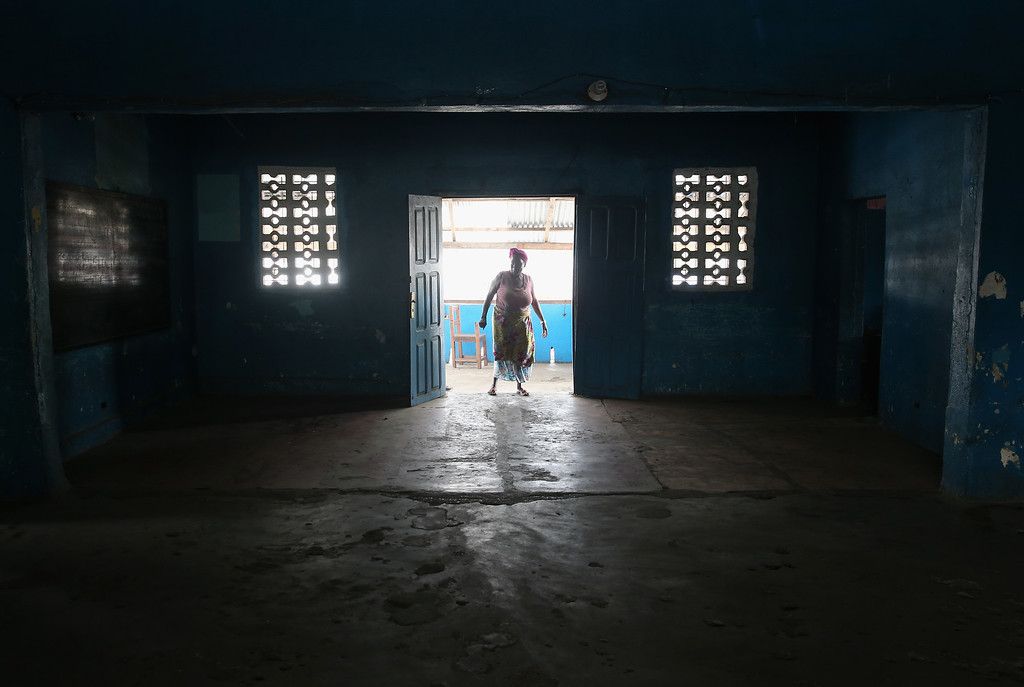 . A school caretaker walks into a kindergarden on January 27, 2015 in Monrovia, Liberia. Although Liberian schools are scheduled to reopen next Monday, February 2, many have not been cleaned nor have adequate supplies since they were closed last March due to the Ebola epidemic. Human contact and public gatherings were highly discouraged to control the epidemic, which has been reduced to single digits of Ebola cases nationwide. (Photo by John Moore/Getty Images)