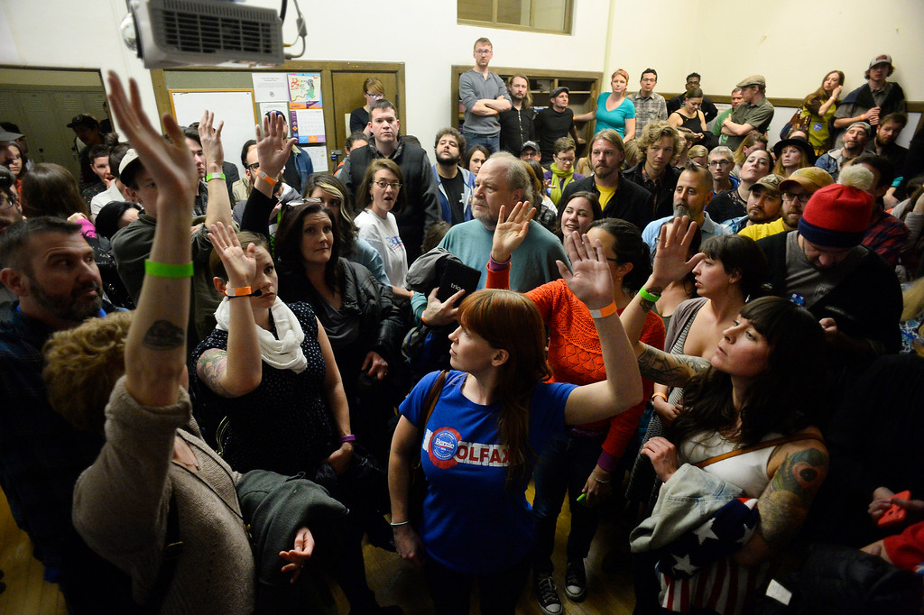 . People raise their hands to be potential delegates for their precinct in a overflowing classroom during the caucus at East High school in Denver, Colorado on March 1, 2016. 18 precincts were represented at East High School and thousands of people turned out for the caucus. Organizers had anticipated about 20% of people from their precincts would turn out but many more actually came. (Photo by Helen H. Richardson/The Denver Post)