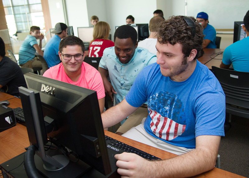 Student Kaleb Pena (right), Jervis Richards and Colton Stagg work together on their daily writing assignment.