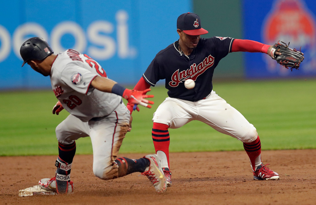. Cleveland Indians\' Francisco Lindor, right, can\'t handle the throw as Minnesota Twins\' Eddie Rosario is safe at second base for a double during the fourth inning of a baseball game Tuesday, Aug. 7, 2018, in Cleveland. (AP Photo/Tony Dejak)