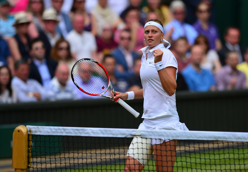 Description of . Czech Republic\'s Petra Kvitova reacts to winning the first set against Canada\'s Eugenie Bouchard during their women\'s singles final match on day twelve of  the 2014 Wimbledon Championships at The All England Tennis Club in Wimbledon, southwest London, on July 5, 2014. (CARL COURT/AFP/Getty Images)