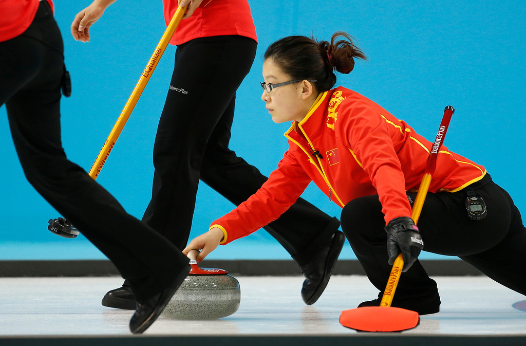 . Chinaís skip Wang Bingyu delivers the rock in a game against Canada during women\'s curling competition at the 2014 Winter Olympics, Monday, Feb. 10, 2014, in Sochi, Russia. (AP Photo/Robert F. Bukaty)