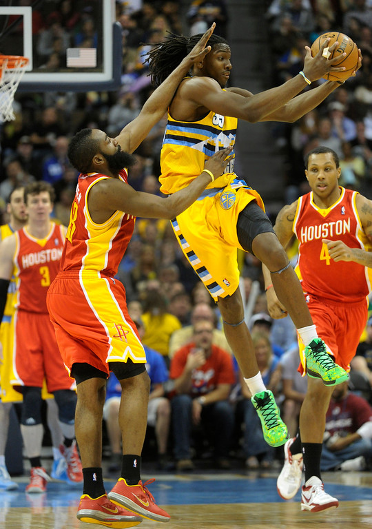. DENVER, CO. - APRIL 6: Kenneth Faried (35) of the Denver Nuggets started a break on offense in the second half. The Denver Nuggets defeated the Houston Rockets 132-114 at the Pepsi Center Saturday night, April 6, 2013. Photo By Karl Gehring/The Denver Post)
