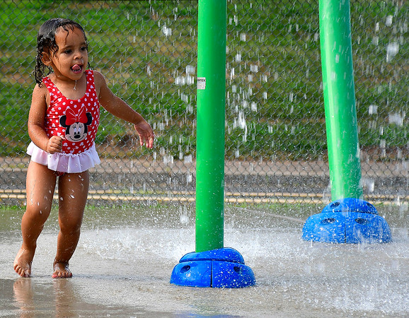 7/30/2019 Mike Orazzi | Staff Kyla Passmore, 2, cools off in the spray park in New Britain's Chesley Park on Tuesday afternoon.