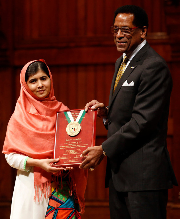 . Malala Yousafzai, left, is presented with the 2013 Peter J. Gomes Humanitarian Award by Director of the Harvard Foundation and Professor of Neurology at Harvard Medical School Dr. S. Allen Counter, right, at Harvard University Friday, Sept. 27, 2013, on the school\'s campus in Cambridge, Mass. The Pakistani teenager, an advocate for education for girls, survived a Taliban assassination attempt last year on her way home from school.  (AP Photo/Jessica Rinaldi)