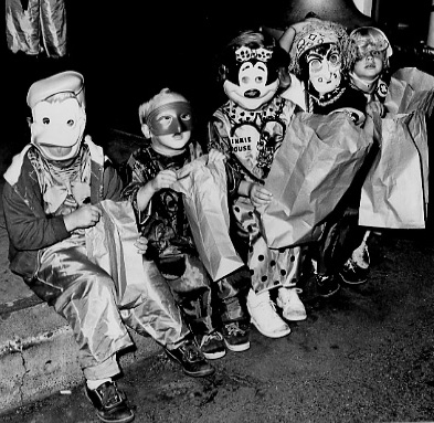 . 1962: Awaiting the start of Santa Clara\'s Halloween parade are, from left, Kathleen Ann Gatjen and the Coston kids, Bobby, Mary Elizabeth, Carol and Connie.  (San Jose Mercury)