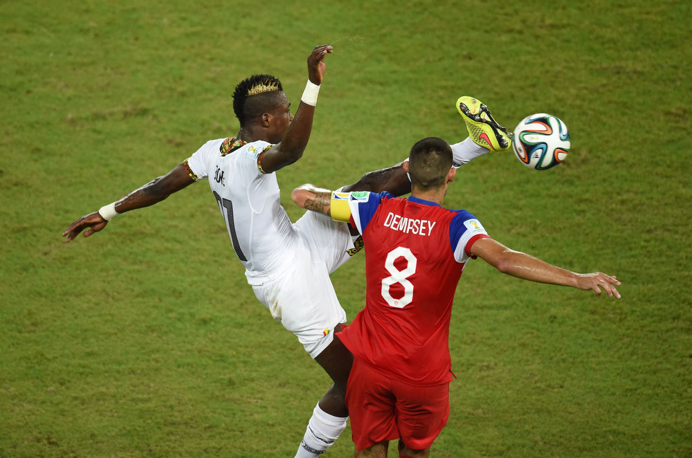 Description of . Ghana's defender John Boye (L) vies with US forward Clint Dempsey during a Group G football match between Ghana and US at the Dunas Arena in Natal during the 2014 FIFA World Cup on June 16, 2014.   JAVIER SORIANO/AFP/Getty Images