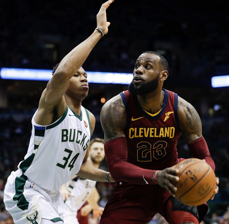 . Cleveland Cavaliers\' LeBron James tries to drive past Milwaukee Bucks\' Giannis Antetokounmpo during the first half of an NBA basketball game Tuesday, Dec. 19, 2017, in Milwaukee. (AP Photo/Morry Gash)