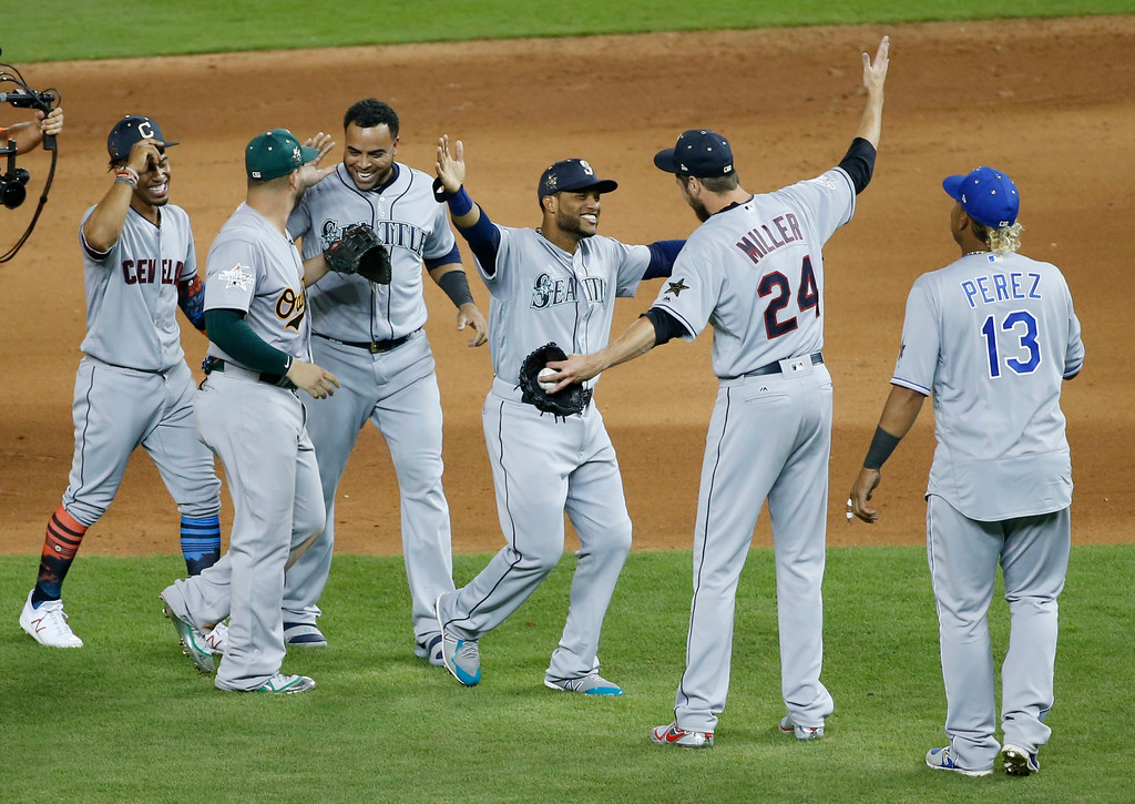 . American League teammates celebrate winning the MLB baseball All-Star Game, Tuesday, July 11, 2017, in Miami. The American League defeated the National League 2-1 in ten innings. Seattle Mariners Robinson Cano (22), third from right, hit the game winning home run. (AP Photo/Wilfredo Lee)