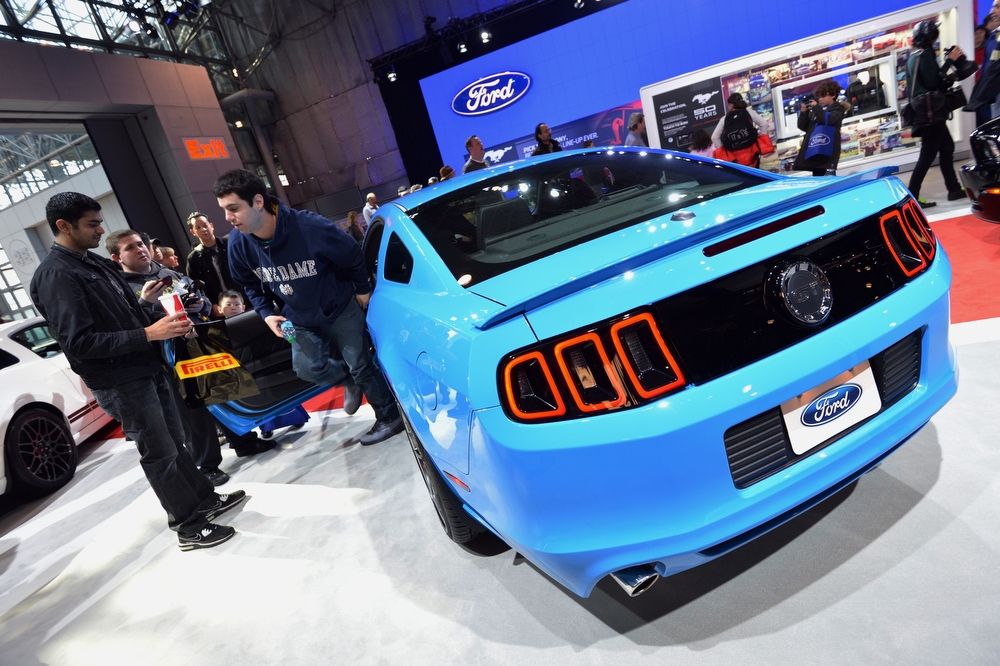 Description of . People view a 2014 Ford Mustang GT coupe at a public preview of the New York International Auto Show on  March 29, 2013 in New York.   STAN HONDA/AFP/Getty Images