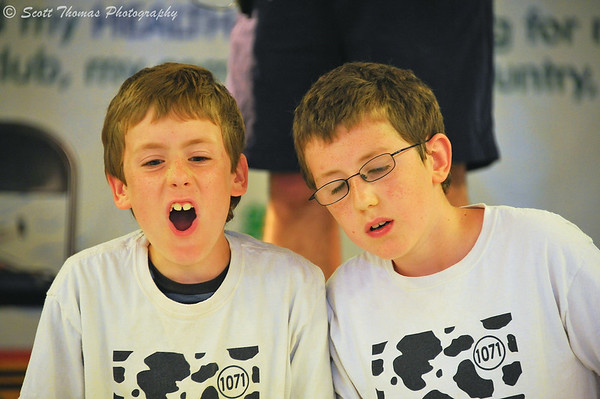Boys react to their robot during a competition inside the Pyrke House 4-H building at The Great New York State Fair in Syracuse, New York on Saturday, August 23, 2014.