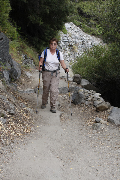 Trekking poles were useful on slippery stretches of aging asphalt covered with sand and pebbles. But not useful at whacking those annoying tiny flies that each of us swallowed at least a couple of.