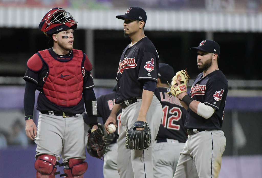 . Cleveland Indian\'s catcher Roberto Perez, left, talks to pitcher Carlos Carrasco in the fourth inning of the final game of a two-game Mayor League Series against the Minnesota Twins at the Hiram Bithorn Stadium in San Juan, Puerto Rico, Wednesday, April 18, 2018. (AP Photo/Carlos Giusti)