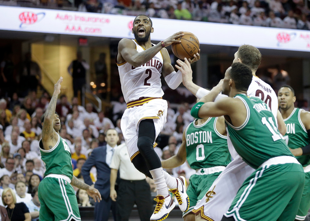 . Cleveland Cavaliers\' Kyrie Irving (2) drives to the basket against the Boston Celtics first round NBA playoff basketball game Sunday, April 19, 2015, in Cleveland. (AP Photo/Mark Duncan)