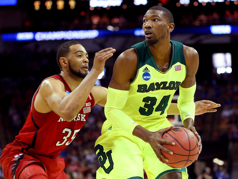 . Cory Jefferson #34 of the Baylor Bears handles the ball against Walter Pitchford #35 of the Nebraska Cornhuskers in the second half during the second round of the 2014 NCAA Men\'s Basketball Tournament at AT&T Center on March 21, 2014 in San Antonio, Texas.  (Photo by Ronald Martinez/Getty Images)