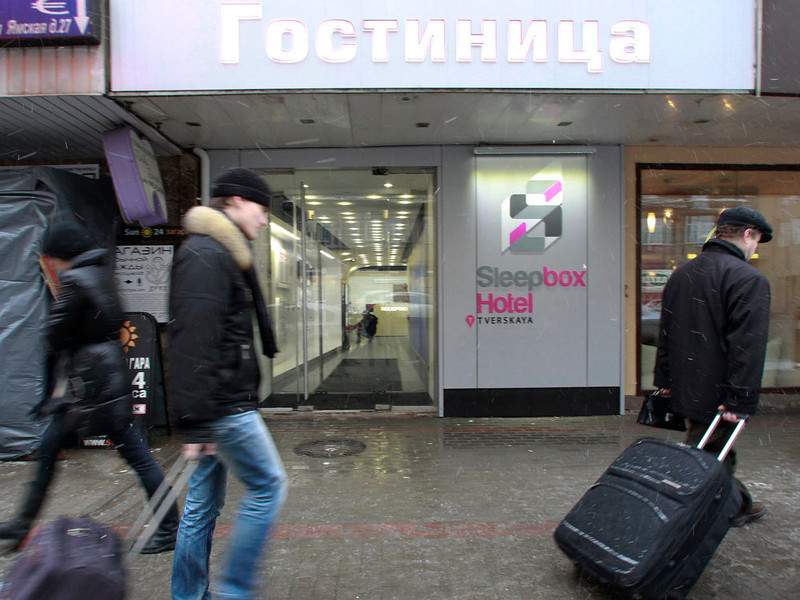 . People walk past the entrance to Moscow\'s first micro hostel February 3, 2013. The hostel offers accommodation for over 100 people in self-contained prefabricated sleeping cells called sleepboxes, according to the hostel administration. REUTERS/Sergei Karpukhin