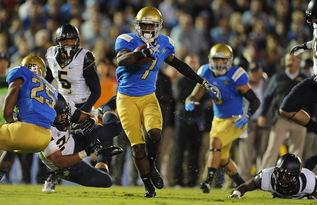 . UCLA wide receiver Devin Fuller (7) catches a pass and runs for a 18-yard touchdown against California during the first half of their college football game in the Rose Bowl in Pasadena, Calif., on Saturday, Oct. 12, 2013.   (Keith Birmingham Pasadena Star-News)