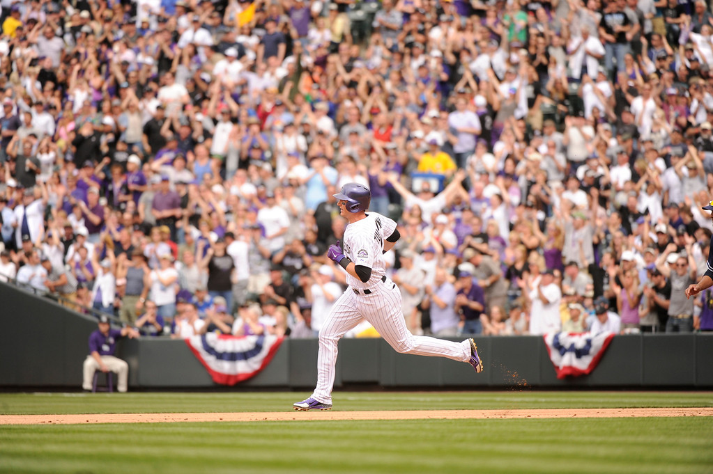 . Troy Tulowitzki (2) of the Colorado Rockies doubles to deep left center, scoring two runs, in the third inning.  (Photo by Karl Gehring/The Denver Post)