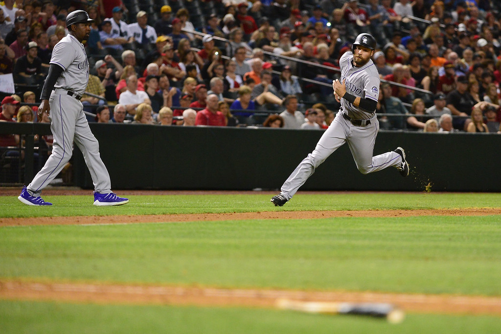 . Ben Paulsen #10 of the Colorado Rockies rounds third bases to score in the ninth inning against the Arizona Diamondbacks at Chase Field on April 30, 2016 in Phoenix, Arizona.  (Photo by Jennifer Stewart/Getty Images)
