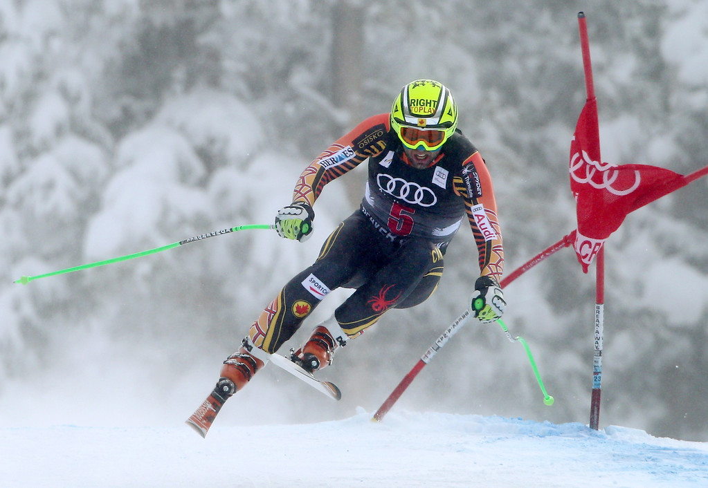 . Canada\'s Manuel Osborne-Paradis clips a gate during the men\'s World Cup downhill skiing event, Friday, Dec. 6, 2013, in Beaver Creek, Colo. (AP Photo/Alessandro Trovati)