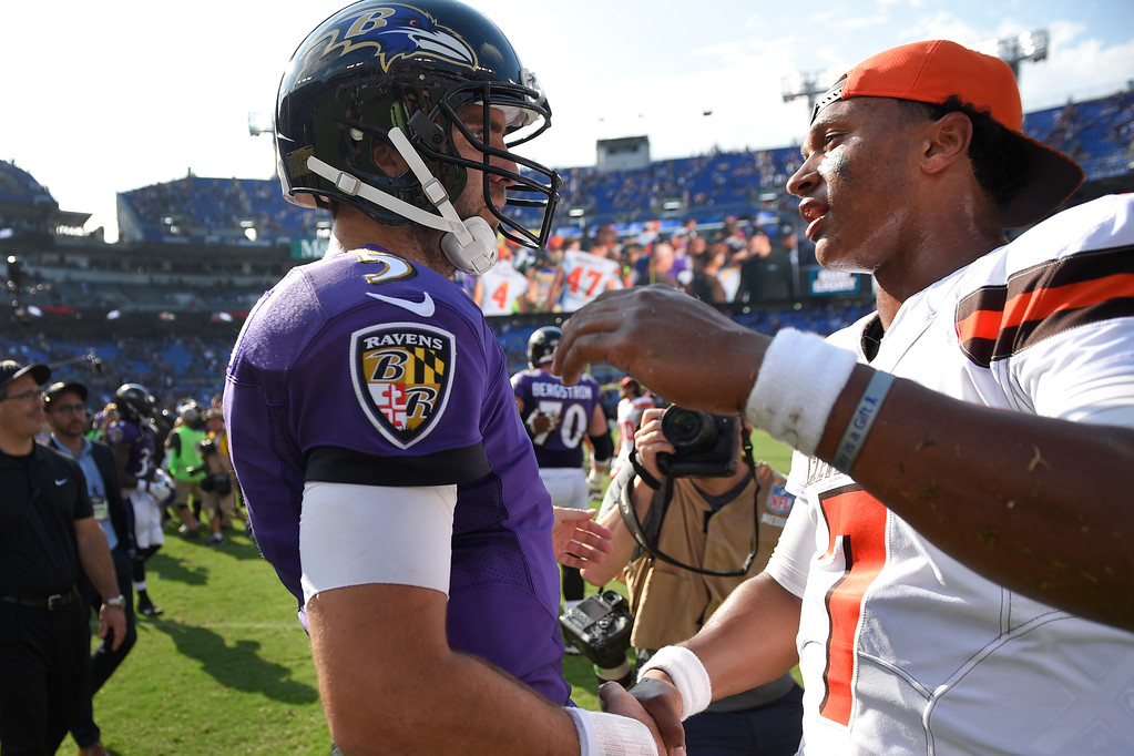. Baltimore Ravens quarterback Joe Flacco (5) greets Cleveland Browns quarterback DeShone Kizer (7) after an NFL football game in Baltimore, Sunday, Sept. 17, 2017. The Ravens defeated the Browns 24-10. (AP Photo/Nick Wass)