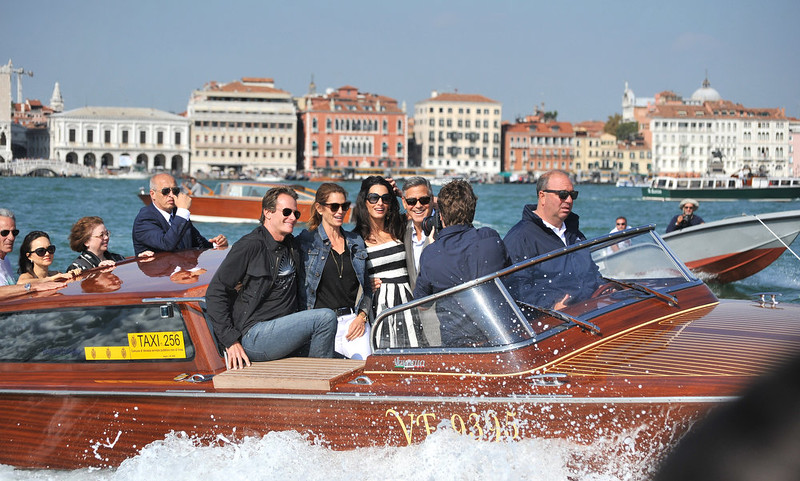 . George Clooney, third right, his fiancee Amal Alamuddin, Cindy Crawford and her husband Rande Gerber cruise past St. Mark\'s Square as they arrive in Venice, Italy, Friday, Sept. 26, 2014. Clooney, 53, and Alamuddin, 36, are expected to get married this weekend in Venice, one of the world\'s most romantic settings. (AP Photo/Luigi Costantini)