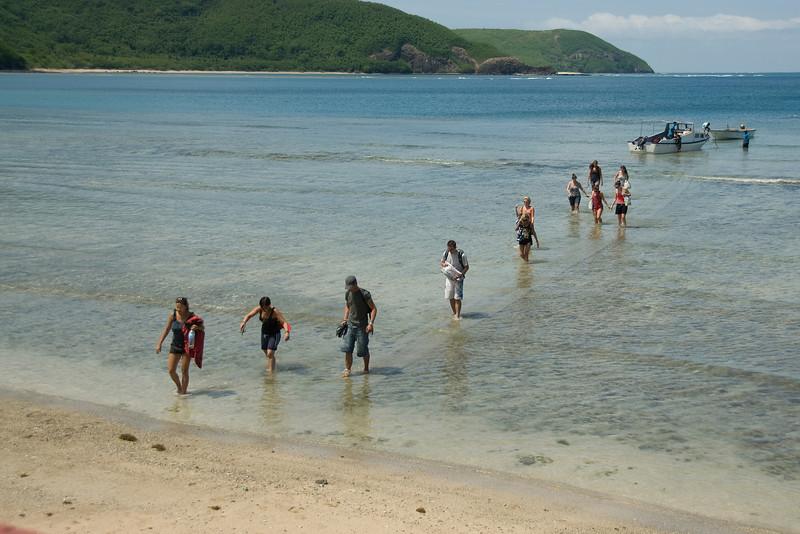 Tourists walking towards the beach - Yasawa Islands, Fiji